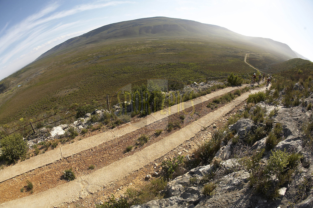 WESTERN CAPE, SOUTH AFRICA -  2 April 2008, riders climb through De Hoop Nature Reserve during stage five of the 2008 Absa Cape Epic Mountain Bike stage race from Swellendam Primary School in Swellendam to Bredasdorp Municipal Sports Grounds in Bredasdorp in the Western Cape, South Africa..Photo by Gary Perkin/SPORTZPICS