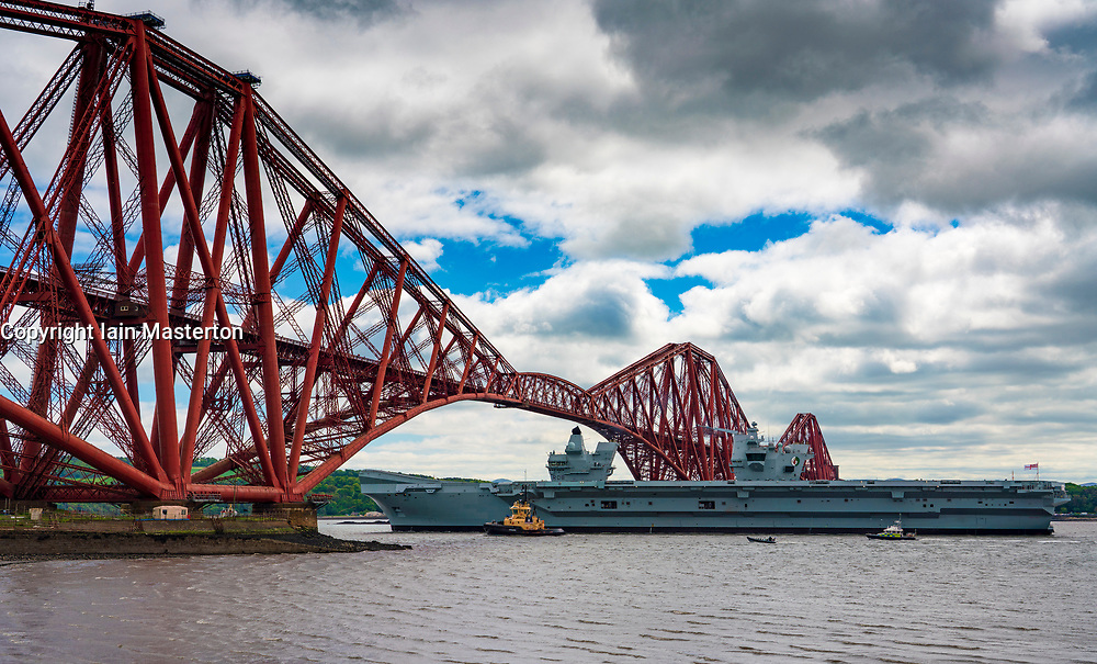 North Queensferry, Scotland, UK. 23 May 2019. Aircraft carrier HMS Queen Elizabeth sails from Rosyth in the River Forth after a visit to her home port for a refit. She returns to sea for Westlant 19 deployment and designed to focus on the operations of her F-35 fighter aircraft. Pictured;