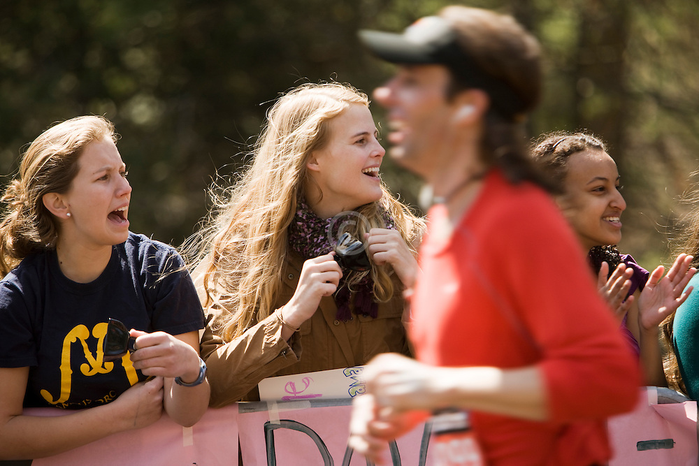 screaming girls ask for kisses as they line the course at Wellesley College near midpoint of race
