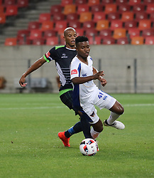 Solomon Mathe of Platinum Stars fails to tackle Menzi Masuku of Chippa United during the 2016 Premier Soccer League match between Chippa United and Platinum Stars held at the Nelson Mandela Bay Stadium in Port Elizabeth, South Africa on the 28th October 2016<br />