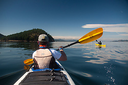 Taylor and Jason Paddle On, Stuart Island, Washington, US