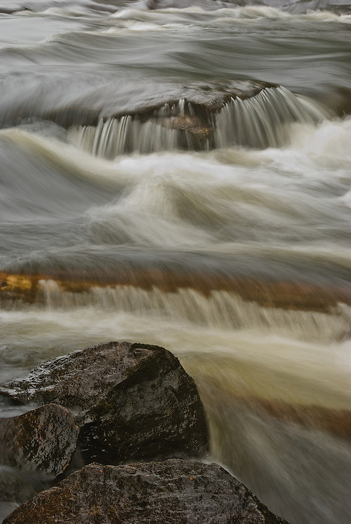Photograph of Buttermilk Falls near Long Lake, NY in the Adirondacks, taken at slow shutter speed to show power and force of river