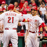 April 6, 2015:   Cincinnati Reds third baseman Todd Frazier celebrates with teammates after hitting a 3-run go ahead home run in the 8th inning of the Reds' 5-2 Opening Day victory over the Pittsburgh Pirates at Great American Ballpark in Cincinnati, OH.