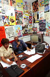 "Jose Ovalles,right, and Elida Polanco co-host the radion program ""Searching for America"" on Radion Perola, a community radio station in western Caracas.  This episode of the show was mostly focused on pro-Chavez and anti-US rhetoric.  Chavez and his government have been increasingly supportive of these generally Chavista community media stations as a response to the anti-chavista private media."