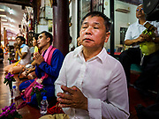 """06 APRIL 2018 - CHIANG MAI, THAILAND:  during the ordination ceremony on the last day of Poy Sang Long at Wat Pa Pao in Chiang Mai. Poy Sang Long (""""The Festival of the Crystal Sons"""") is a ceremony that marks a rite of passage among the Buddhist Shan people in Myanmar and northern Thailand. Boys between seven and fourteen years of age are ordained as Buddhist novices during a three day ceremony.     PHOTO BY JACK KURTZ"""