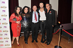 Left to right, JODIE PRENGER, LISA RILEY, DAVID PENDLEBURY Chairman of the Make A Difference Trust, RYLAN CLARK and GOK WAN at West End Eurovision 2013 held at the  Dominion Theatre, London on 23rd May 2013.