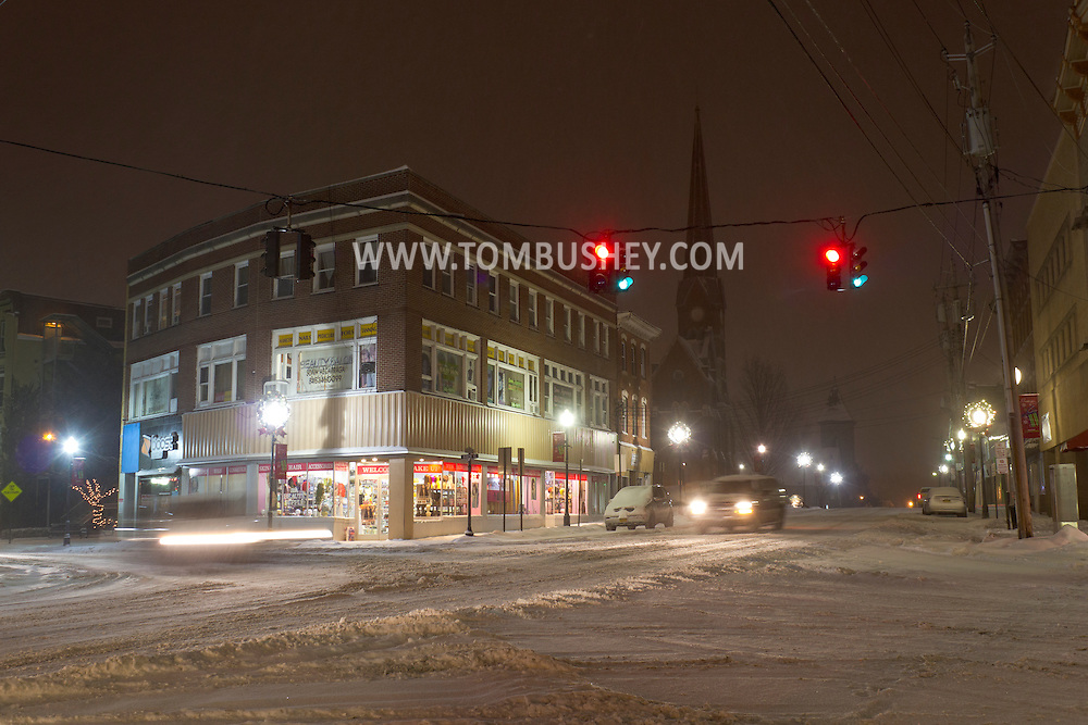 Middletown, New York - Cars in the intersection at Franklin Square during a snowstorm on Dec. 22, 2013.
