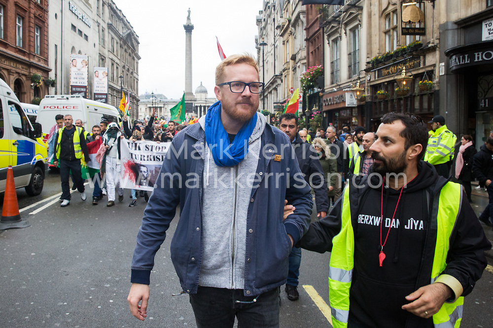 London, UK. 13 October, 2019. Lloyd Russell-Moyle, Labour MP for Brighton Kemptown, joins members of the UK's Kurdish community marching in protest against Turkey's invasion of Kurdish-held territory in north-eastern Syria.