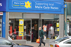 © London News Pictures. 14/07/2013. COPY AVAILABLE BELOW…. Marie Curie charity shop on Orpington High Street, Kent. Orpington High street now has 12 charity shops  in one short stretch, with Cancer Research UK having two shops on different sides of the high street almost facing each other.  COPY AVAILABLE HERE:  http://tinyurl.com/nhtxtyd<br /> <br /> Photo credit :Grant Falvey/LNP