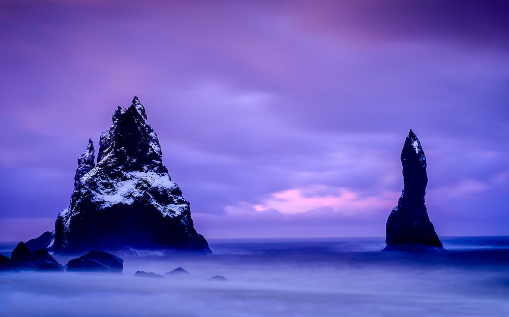 VIK, ICELAND - CIRCA MARCH 2015: Black sand beach of Reynisfjara, near Vik, and basalt sea stacks in southern Iceland at sunrise.