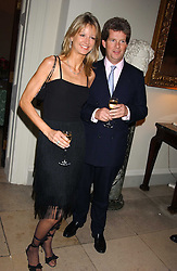 GUY & FIONA SANGSTER at the Bruce Oldfield Crimestoppers Party held at Spencer House, 27 St.James's Place, London SW1 on 22nd September 2005.<br />