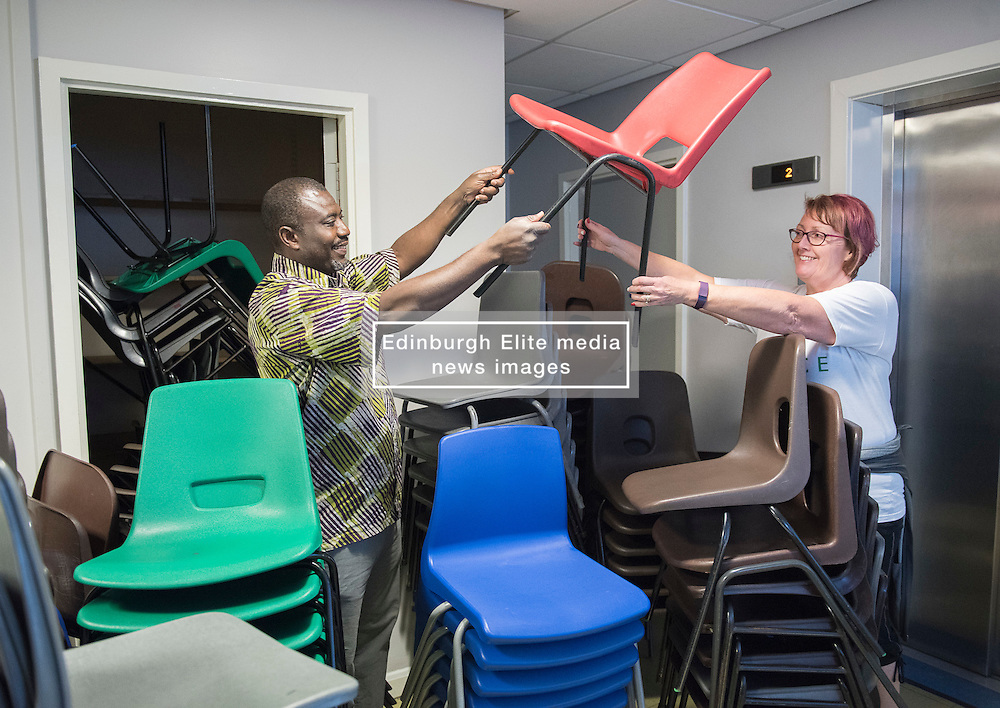 A thousand desks and a thousand chairs from the now closed Portobello High School are set to embark on a new life - in Africa. The City of Edinburgh Council is working with a number of partners, including charity Chance for Africa, to find new homes for surplus equipment from the 1960s building. While some equipment is being moved to other schools across the city, some is travelling much further. Former pupil Sandra Abdulai returned to her old school, along with her husband Zak Abdulai, founder of Chance for Africa to help start the tables and chairs off on their journey. Pictured: Zak Abdulai and Sandra Abdulai<br /> <br /> <br /> © Jon Davey/ EEm