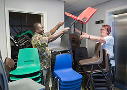 A thousand desks and a thousand chairs from the now closed Portobello High School are set to embark on a new life - in Africa. The City of Edinburgh Council is working with a number of partners, including charity Chance for Africa, to find new homes for surplus equipment from the 1960s building. While some equipment is being moved to other schools across the city, some is travelling much further. Former pupil Sandra Abdulai returned to her old school, along with her husband Zak Abdulai, founder of Chance for Africa to help start the tables and chairs off on their journey. Pictured: Zak Abdulai and Sandra Abdulai<br /> <br /> <br /> &copy; Jon Davey/ EEm