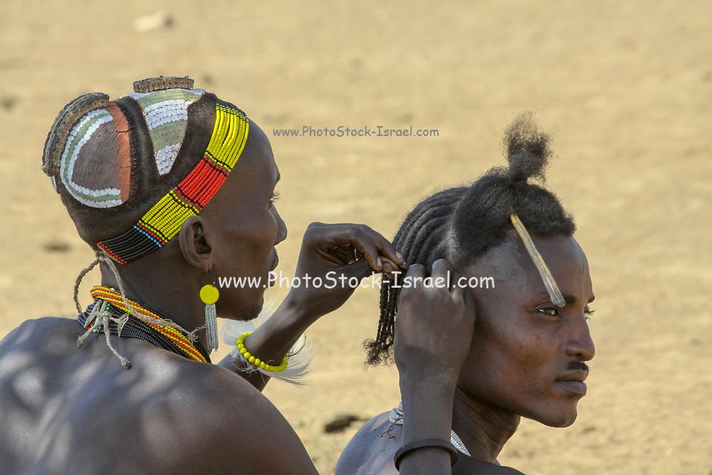 Daasanach tribe village the male elders sit around idle. Africa, Ethiopia, Omo Valley,