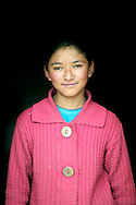 India, Ladakh. Portrait of a young girl  from Spangmik.