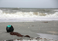 A float for a crab pot washes up from the Gulf of Mexico on a Sanibel Island beach.
