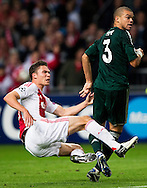 Real Madrid's   Pepe vies with Ajax Amsterdam's  Derk Boerrigter during the UEFA Champions League Group D football match Ajax Amsterdam vs Real Madrid on October 3, 2012 AFP PHOTO/ ROBIN UTRECHT.