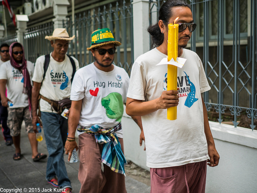 22 JULY 2015 - BANGKOK, THAILAND:  People march around Government House, which is the office of the Prime Minister. More than 100 people from Krabi province and members of the Save Andaman from Coal Network (SACN) have staged a series of marches and sit-ins outside the Prime Minister's office Bangkok. They are opposed to plans to build an 800 megawatt coal fired power plant near southern Thailand's Andaman coast about 650 kilometers (400 miles) south of Bangkok. The area is famous for its pristine beaches. Residents worry that the coal fired power plant will pollute the area and send power to Bangkok.   PHOTO BY JACK KURTZ