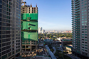 A view of Makati, with Garden Towers under construction on the left, and the Park Terraces building on the right on Palm Drive, Makati, Metro Manila, Philippines.  (photo by Andrew Aitchison / In pictures via Getty Images)