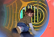 Playing in the tunnel of the nursery playground.