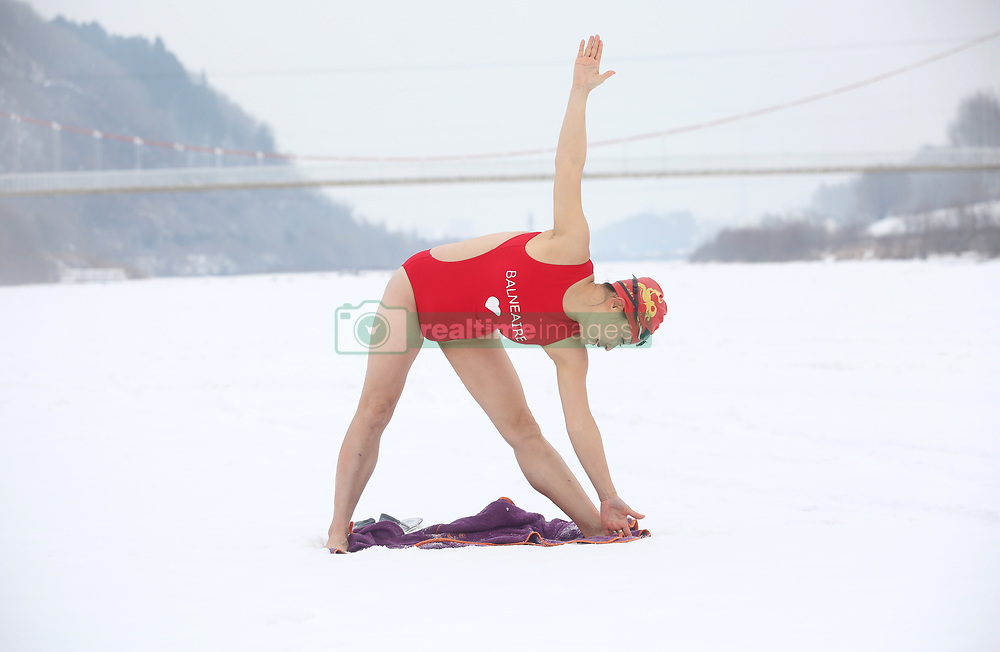 January 31, 2018 - Yichun, Yichun, China - Yichun,CHINA-January 2018: A woman in swimsuit practices yoga in freezing weather of minus 28 degree Celsius in Yichun, northeast China's Heilongjiang Province. (Credit Image: © SIPA Asia via ZUMA Wire)