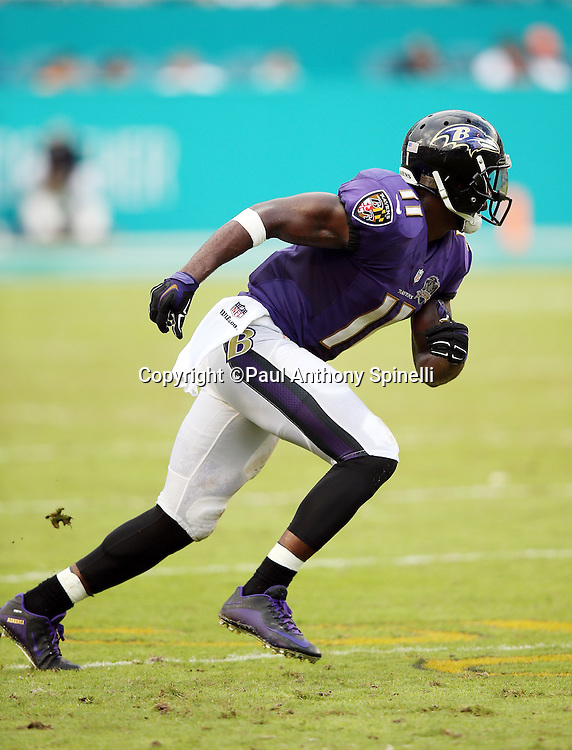 Baltimore Ravens wide receiver Kamar Aiken (11) goes out for a pass during the 2015 week 13 regular season NFL football game against the Miami Dolphins on Sunday, Dec. 6, 2015 in Miami Gardens, Fla. The Dolphins won the game 15-13. (©Paul Anthony Spinelli)