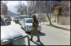 A British Soldier walks in the in streets of Kabul, Afghanistan, as the MOD Imam Asim Hafiz visit the city on the 18th January 2014, as he heads to Kabul, Picture by Andrew Parsons / Parsons Media Ltd