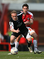 Photo: Rich Eaton.<br /> <br /> Bristol City v Swansea City. Coca Cola League 1. 07/04/2007. Thomas Butler left of Swansea and Bristols Lee Johnson go for the ball