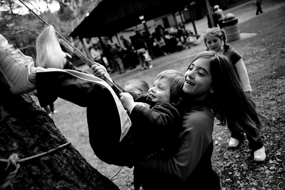 Christian Theroux (left) and Analee Bonano play during a picnic held by the Italian community in Monterey, CA on Sunday, January 27, 2007.