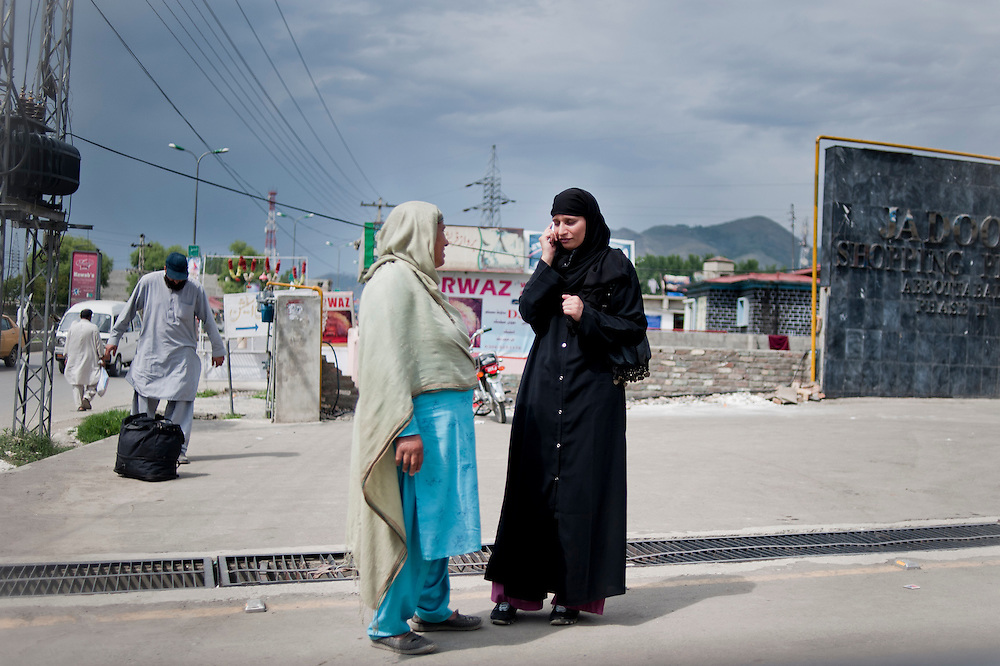 Women stand on a footpath of Abbottabad, Khyber Pakhtunkhwa province, Pakistan on May 5, 2011. US special forces laucnhed an agressive attack on the compound early morning on May 2 killing Osama bin Laden.