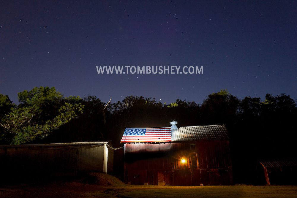 Middletown, New York - Stars shine about an American flag painted on a a barn roof on May 19, 2012.