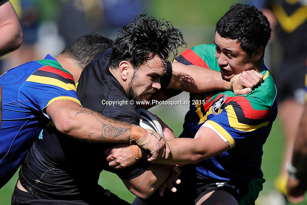 Denzil Hokianga (C of the Orcas is tackled by Nick Read of the Stallions (R during the NRL National Premiership rugby league match between Wellington Orcas v Wai-Coa-Bay Stallions at Porirua Park in Wellington on Saturday the 12th September 2015. Copyright photo by Marty Melville / www.photosport.nz