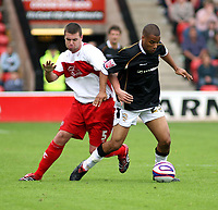 Photo: Mark Stephenson.<br /> Walsall v Port Vale. Coca Cola League 1. 08/09/2007.<br /> Port Vale's Paul McGoldrick on the ball from Walsall's Anthony Gerrard