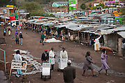 Vendors push trolleys at a market Narok, Kenya, after an afternoon rainstorm.
