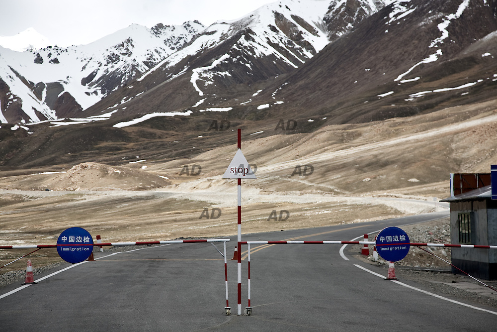 The Chinese border before entering the no man's land.<br /> ***General caption ***<br /> The Karakoram Highway (KKH) is the highest paved international road in the world. It connects China and Pakistan across the Karakoram mountain range, through the Khunjerab Pass, at an elevation of 4,693 metres.<br /> It connects China's Xinjiang region with Pakistan's Gilgit&ndash;Baltistan and Khyber regions.<br /> It was told me that there was a new route for Chinese goods. A new route that would allowed it to jump all over the South China Sea and arrive directly on the Arabian Sea, to the Gwadar port.<br /> It was a story that there was no, actually.<br /> Maybe one day there will be this route. But it did not exist when I did it, in 2009.<br /> Just few trucks climbed it and an Indian trader, who was traveling with me, told me that his goods would have paid much less traveling by sea from Shenzhen, rather than overland through Xinjiang and the KKH. And it would take even less time.<br /> It was a nice trip, however. In one of the most remote places on earth. You could hear the echo of the attacks of the Taliban, we had to wait a couple of hours to release the road to a car exploded on a bridge. At press office in Islamabad they told me that it was impossible to visit Gwadar. So I went to Karachi, where I made a reportage about the secular party MQM, then published &quot;Ventiquattro&quot;.
