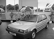 """Nissan Launches New """"Sunny""""..1986..21.08.1986..08.21.1986..21st August 1986..Nissan Ireland launched the all new integrated Sunny range on to the Irish market.The launch was the European premiere of this model and marked a significant second phase in the rationalisation of the Nissan Product range. The first Phase was the launch of the Bluebird range in February of this year. The Launch took place at Nissan House, Naas Road Dublin...Image shows Mr Tony Kelly,Deputy Managing Director,Nissan,Ireland (right) and Mr Gerard O'Toole,Managing Director,Nissan Ireland at the """"Sunny"""" launch."""