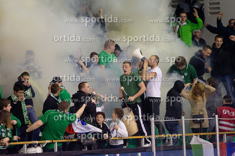 Fans of HDD Tilia Olimpija celebrate during ice-hockey match between HDD Tilia Olimpija and EHC Liwest Black Wings Linz at fourth match in Semifinal  of EBEL league, on March 13, 2012 at Hala Tivoli, Ljubljana, Slovenia. (Photo By Matic Klansek Velej / Sportida)