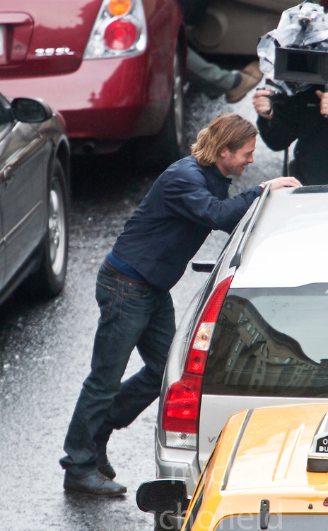 "Day two of filming. Brad Pitt gets a fright from the gun blast on the set of the movie ""World War Z"" being shot in the city centre of Glasgow. The film, which is set in Philadelphia, is being shot in various parts of Glasgow, transforming it to shoot the post apocalyptic zombie film.."