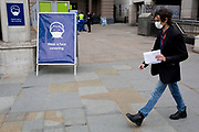 As the UK's Conornavirus pandemic lockdown continues, but with travel restrictions and social distancing rules starting to ease after three months of closures and isolation, Londoners walk past large signs at Charing Cross station, advising the public to wear face coverings, a government requirement on all public transport from June 15th next week, on 9th June 2020, in London, England.