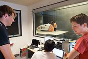 Teamleider Paul Denissen (links) kijkt zeer tevreden naar de meetwaarden van de VeloX2. Op de TU Delft wordt de VeloX2 getest in de windtunnel. Met de VeloX2 wil het Human Powered Team Delft en Amsterdam, bestaande uit studenten van de TU Delft en de VU Amsterdam, het werelduurrecord en het sprint record gaan breken.<br /> <br /> Team captain Paul Denissen (left) is happy when he sees the results of the measurements. The VeloX2 is tested on aerodynamics at the wind tunnel of TU Delft. With the VeloX2 the Human Powered Team Delft and Amsterdam are trying to break the speed records for human powered vehicles.