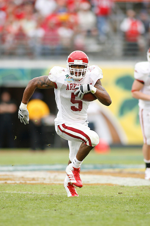 University of Arkansas running back Darren McFadden rushes upfield during the Wisconsin Badgers 17-14 victory over the Arkansas Razorbacks in the Capital One Bowl at the Florida Citrus Bowl Stadium in Orlando, Florida on January 1, 2007.