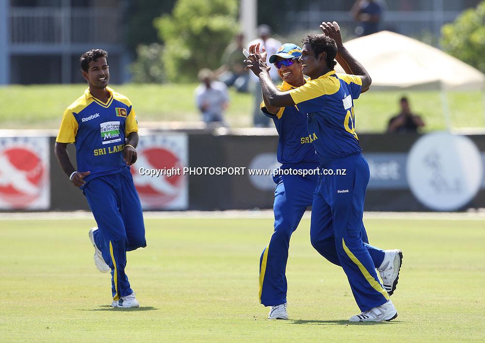 Sri Lanka celebrate the wicket of BB McCullum.<br /> New Zealand Black Caps v Sri Lanka, international exhibition Twenty 20 cricket match, Central Broward Regional Park, Florida, United States of America. 22 May 2010. Photo: Barry Bland/PHOTOSPORT
