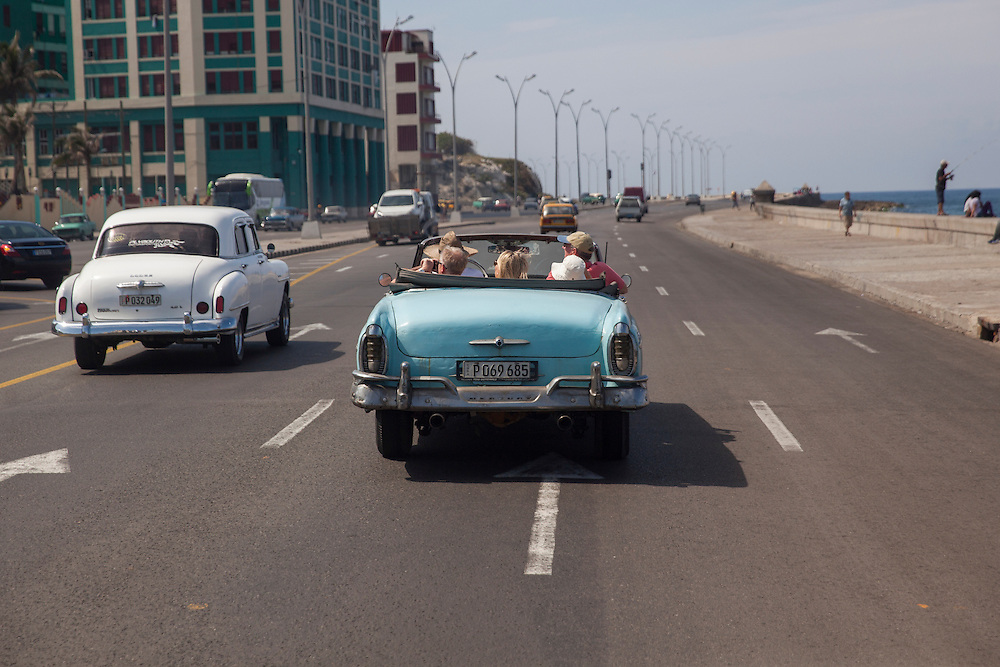 Convertible taxi cruising Malecon avenue in Havana, Cuba.