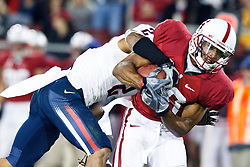 November 6, 2010; Stanford, CA, USA;  Stanford Cardinal wide receiver Doug Baldwin (89) is tackled by Arizona Wildcats cornerback Mike Turner (2) during the third quarter at Stanford Stadium.  Stanford defeated Arizona 42-17.