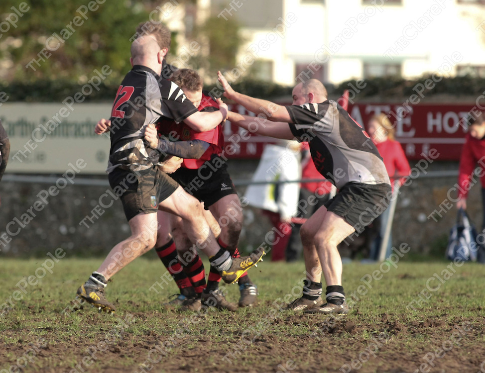 Ennis RFC Niall Nevin &amp; Scarriff RFC Steve Madden &amp; Tom Cronin in action during their Game played in Showgrounds Ennis Co.Clare..<br /> Picture Credit  Brian Gavin Press 22
