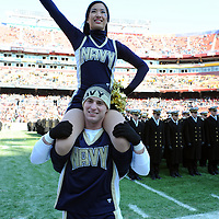10 December 2011:   A Navy Midshipmen cheerleader takes the field prior to the game against the Army Black Knights at Fed Ex field in Landover, Md. in the 112th annual Army Navy game where Navy defeated Army, 27-21 for the 10th consecutive time..