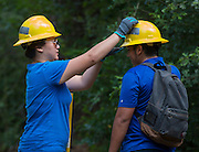 Westside High School senior Alice Yet, left, helps out a colleague while working on a trail at the Houston Arboretum during the Student Conservation Association Houston (SCA) Summer Community Crew Program, July 21, 2014.