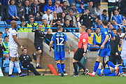 Calvin Andrew gets a yellow card during the EFL Sky Bet League 1 match between Gillingham and Rochdale at the MEMS Priestfield Stadium, Gillingham, England on 30 March 2019.