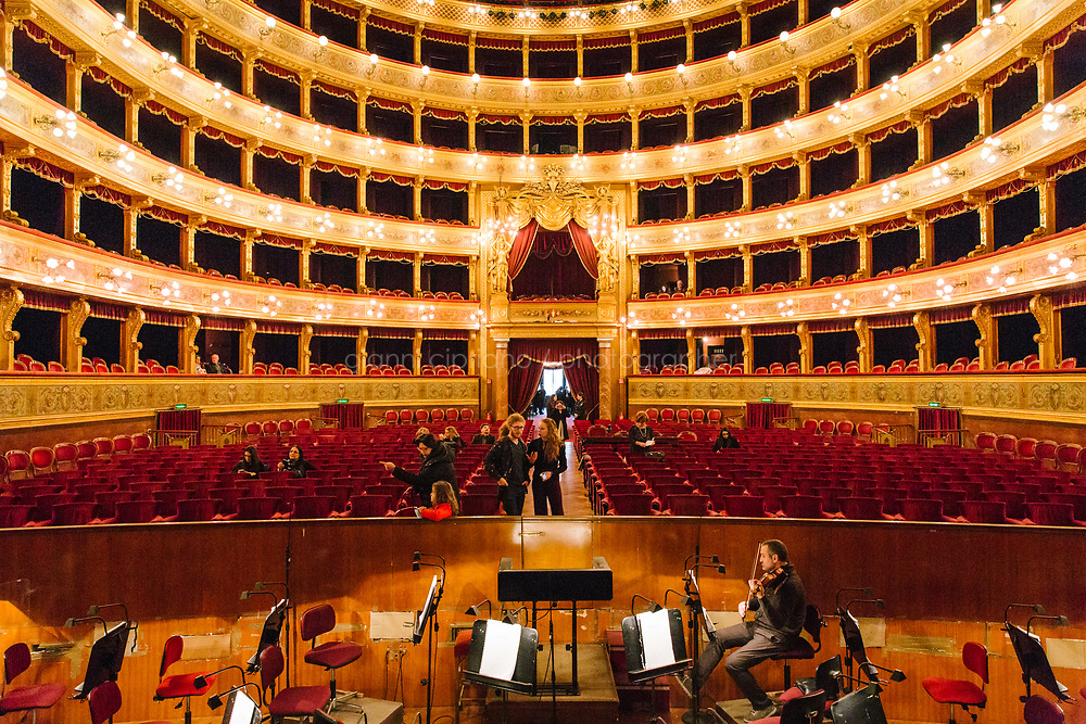 PALERMO, ITALY - 18 FEBRUARY 2018: A view the auditorium and the orchestra pit is seen here from the stage of the Teatro Massimo in Palermo, Italy, on February 18th 2018.<br /> <br /> The Teatro Massimo Vittorio Emanuele is an opera house and opera company located  in Palermo, Sicily. It was dedicated to King Victor Emanuel II. It is the biggest in Italy, and one of the largest of Europe (the third after the Op&eacute;ra National de Paris and the K. K. Hof-Opernhaus in Vienna), renowned for its perfect acoustics. It was inaugurated in 1897.