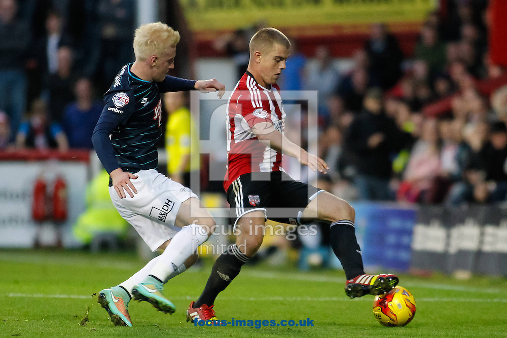 Will Hughes of Derby County and Jake Bidwell of Brentford during the Sky Bet Championship match between Brentford and Derby County at Griffin Park, London<br /> Picture by Mark D Fuller/Focus Images Ltd +44 7774 216216<br /> 01/11/2014